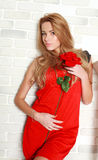 Passionate woman with red rose in studio, girl and flower. Beauty and love concept Royalty Free Stock Images