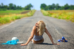 Passionate woman sitting on road Royalty Free Stock Images