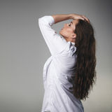 Passionate young brunette on grey background Stock Image