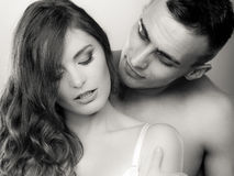 Passionate young people in love, woman and man Royalty Free Stock Photos
