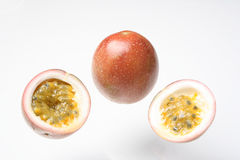 Passionfruit. Passion fruit with yellow juicy pulp and black seeds Stock Photos