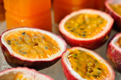 Passionfruit in a half and juice Royalty Free Stock Photos