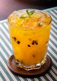 Passionfruit juice with ice ready fro drink. Passionfruit juice with ice and mint leaf for drink royalty free stock photo