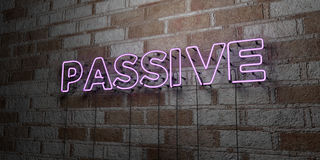 PASSIVE - Glowing Neon Sign on stonework wall - 3D rendered royalty free stock illustration Royalty Free Stock Photo