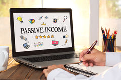 Passive Income Concept On Laptop Monitor. Passive Income Concept With Various Hand Drawn Doodle Icons On Laptop Monitor royalty free stock photography