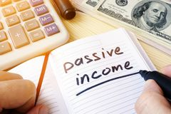Passive income written in a note. Passive income written in a note and money royalty free stock photos