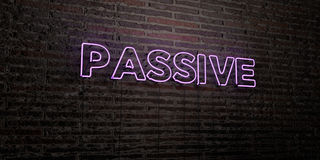 PASSIVE -Realistic Neon Sign on Brick Wall background - 3D rendered royalty free stock image Stock Photo