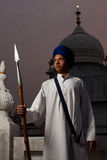 Passive Sikh Boy Spear Paonta Sahib. PAONTA SAHIB - MAY 22: A Sikh boy holds a spear at Paonta Sahib Gurudwara, famous for its past warriors May 22, 2009 in royalty free stock photos