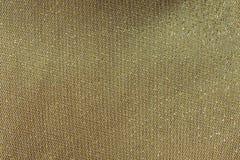 Passo dell'oro su tessuto, fondo di lusso dorato Fotografie Stock