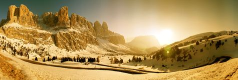Passo Gardena Panorama, Italy. 150 Degree sunset winter panorama of the road to Val Gardena Pass in the Italian Alps near Selva die Val Gardena, Alto Adige Royalty Free Stock Image