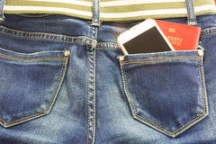 Passort and mobile in blue jeans pocket means  journey Royalty Free Stock Photos