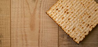 Handmade Matzot on weathered wooden background with copy-space.F. Passover background. Handmade  matzoh jewish passover bread over wooden background. Flat Lay Stock Photography