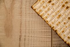 Jewish traditional  Passover Matzot on rustic wooden background. Passover background. Jewish traditional Matzah top view on rustic wooden background with copy Stock Photos