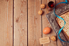 Passover background with matzo, wine and egg. Royalty Free Stock Photography