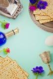 Passover background with matzo, wine and flowers. Jewish holiday celebration Stock Image
