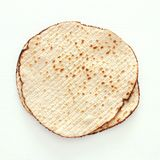 Passover background with matzoh isolated on white. Passover background with matzoh isolated on white Royalty Free Stock Photography