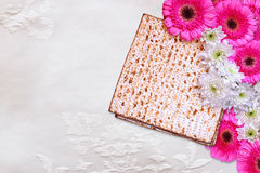 Passover background. matzoh (jewish passover bread) and flowers on white table cloth Stock Photo