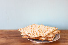 Passover background. matzoh (jewish passover bread)  over wooden background. Stock Photo