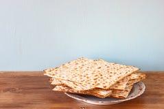 Passover background. matzoh (jewish passover bread) over wooden background. stock photo