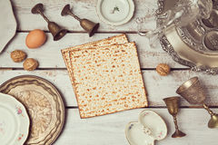 Passover background with matzoh on wooden table. View from above. Royalty Free Stock Image