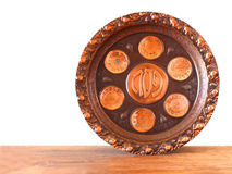 Passover background  plate  jewish passover bread  over wooden background  isolated Royalty Free Stock Image
