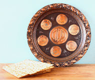 Passover background  plate and matzoh  jewish passover bread  over wooden background Royalty Free Stock Photo