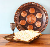 Passover background  plate, wine and matzoh  jewish passover bread  over wooden background Royalty Free Stock Photography