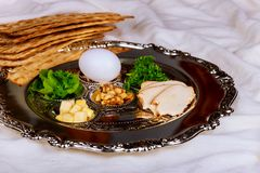 Passover background with wine bottle, matzoh, egg and seder plate stock photos