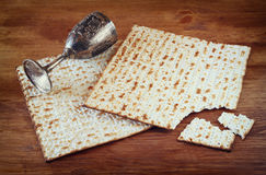 Passover background. wine cup and matzoh (jewish passover bread) over wooden background Royalty Free Stock Photography