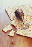 Passover background. wine cup and matzoh (jewish passover bread) over wooden background Stock Photography
