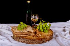 Passover background. wine and matzoh jewish holiday bread over wooden board. Symbols of Passover background. wine and matzoh jewish holiday bread over wooden Stock Photography