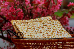 Passover background. wine and matzoh jewish holiday bread wooden table Stock Image