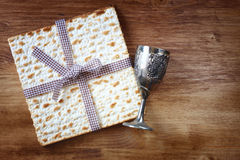 Passover background. wine and matzoh (jewish passover bread). Over wooden background Stock Photos