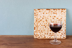 Passover background. wine and matzoh (jewish passover bread)  over wooden background. Royalty Free Stock Photos