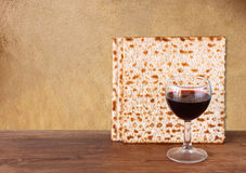 Passover background. wine and matzoh (jewish passover bread)  over wooden background Royalty Free Stock Image