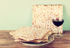 Passover background. wine and matzoh (jewish passover bread)  over wooden background. Vintage effect process Stock Photography