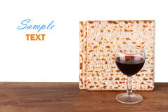 Passover background. wine and matzoh (jewish passover bread)  over wooden background Stock Image