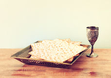 Passover background  wine and matzoh  jewish passover bread  over wooden background. Pic Royalty Free Stock Photography