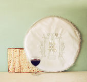Passover background. wine and matzoh (jewish passover bread) over wooden background. Royalty Free Stock Images