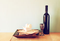Passover background. wine and matzoh (jewish passover bread) over wooden background. Stock Photo