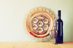 Passover background. wine and matzoh (jewish passover bread) over wooden background. Stock Photos