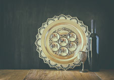 Passover background. wine and matzoh (jewish passover bread) over wooden background Stock Photography