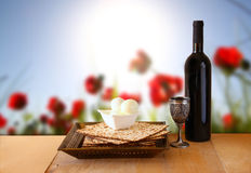 Passover background. wine and matzoh (jewish passover bread) over wooden background Stock Images