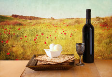 Passover background. wine and matzoh (jewish passover bread) over wooden background Royalty Free Stock Photos