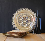 Passover background. wine and matzoh (jewish passover bread) over wooden background.  Stock Image