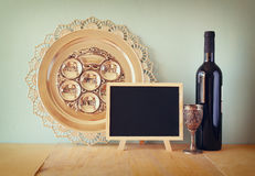 Passover background. wine and matzoh (jewish passover bread) over wooden background Royalty Free Stock Images