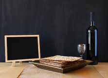 Passover background. wine and matzoh (jewish passover bread) over wooden background Royalty Free Stock Photography