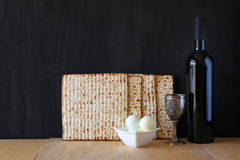 Passover background. wine and matzoh (jewish passover bread) over wooden background Stock Photos