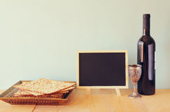 Passover background. wine and matzoh (jewish passover bread) over wooden background Stock Photo