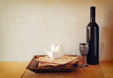 Passover background. wine and matzoh (jewish passover bread) over wooden background Royalty Free Stock Photo